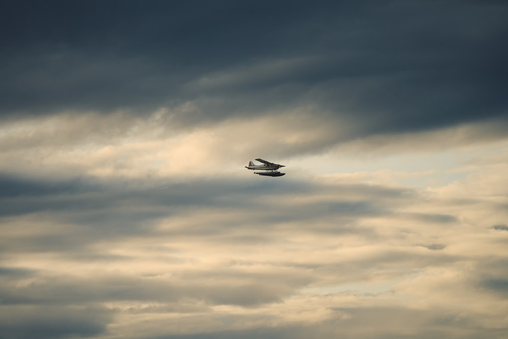 airplane by the clouds