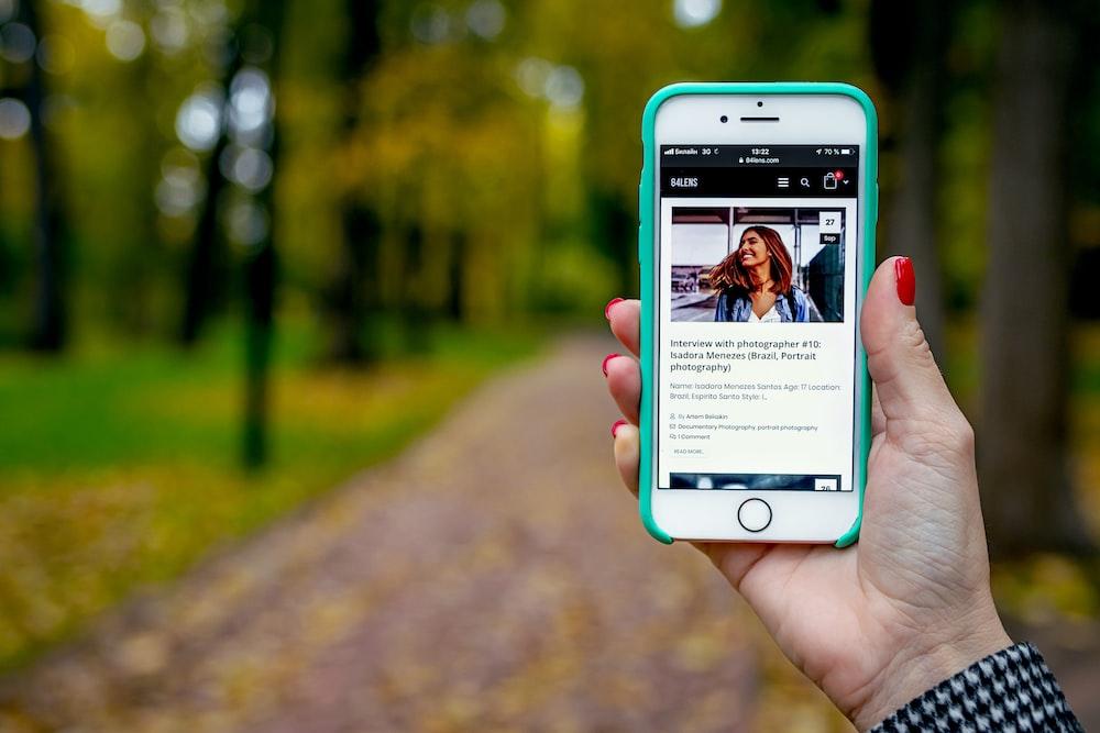 iPhone 6 displaying woman wearing blue jacket