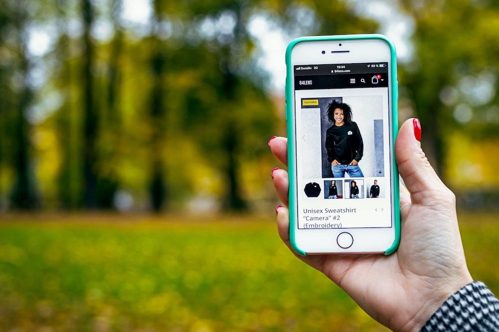 woman in black sweater in iPhone display