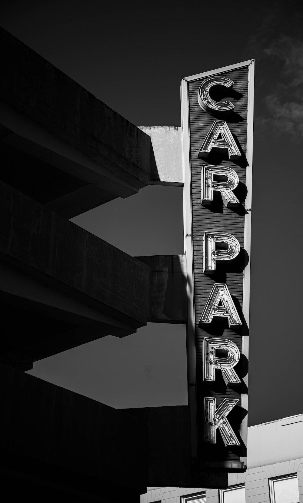 greyscale photography of car park signage