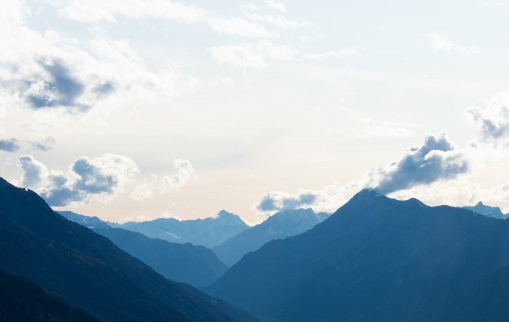 view of mountains under white skies