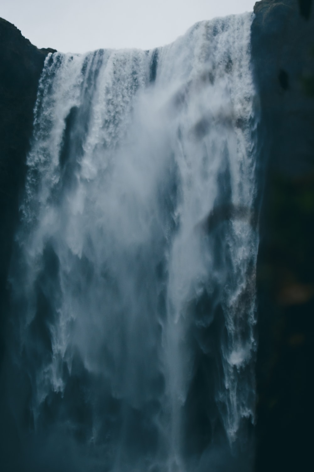 low-angle photography of waterfall