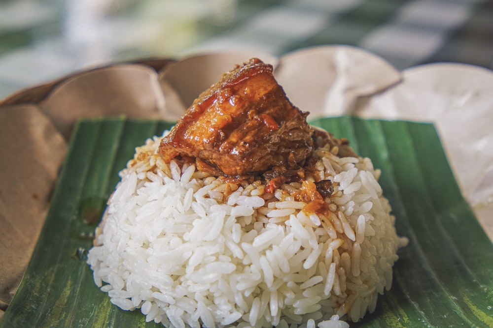 steamed rice with adobong pork on top