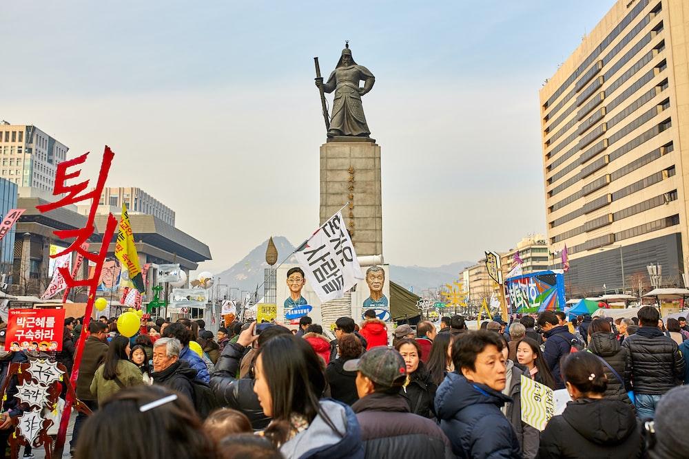 people near statue