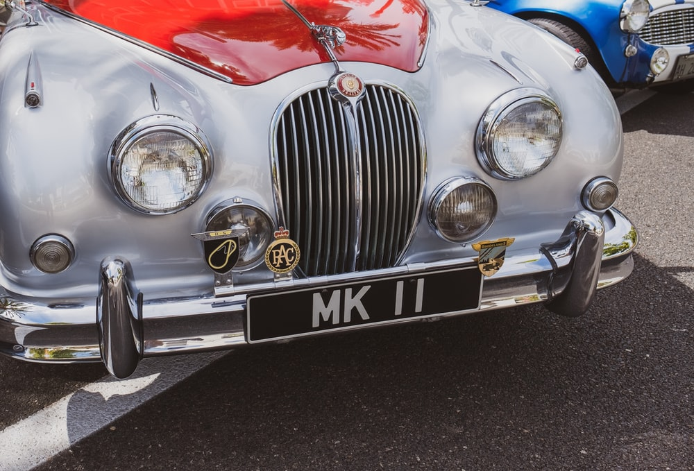 white and red Jaguar Mark 1 vehicle