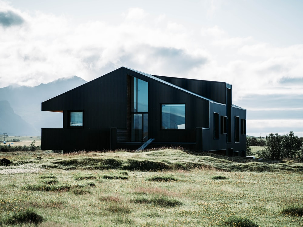 black 2-storey house under white clouds