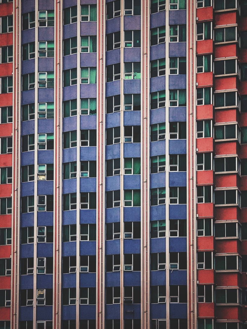 blue and red high-rise building