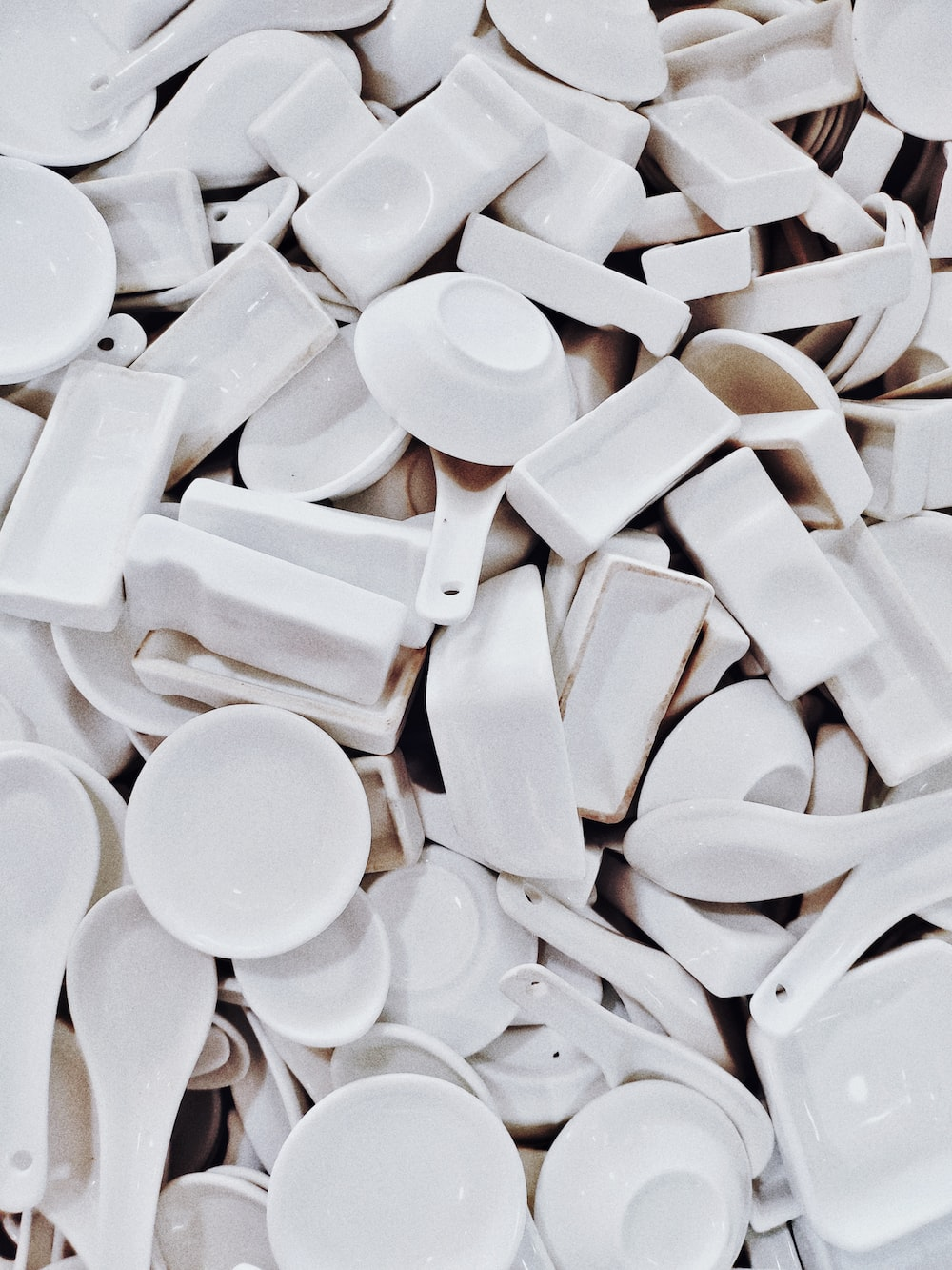 white ceramic bowls and spoons