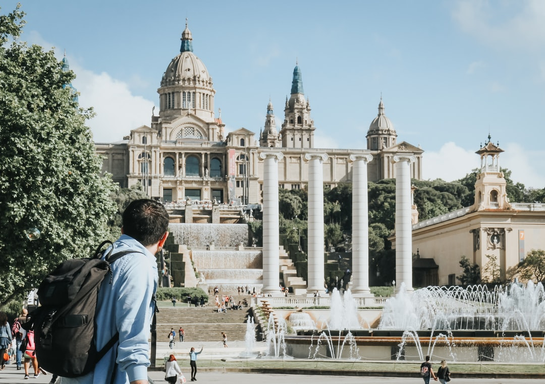 Man admiring the architectural wonder of the Museu Nacional d'Art de Catalunya (National Museum of Art of Catalonia)