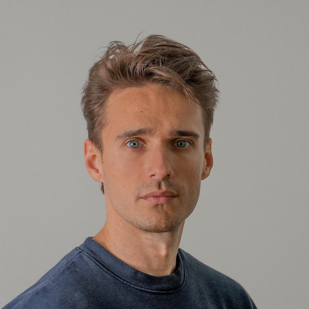man wearing blue crew-neck shirt