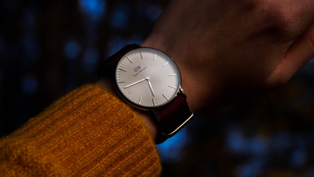 round silver-colored and white analog watch