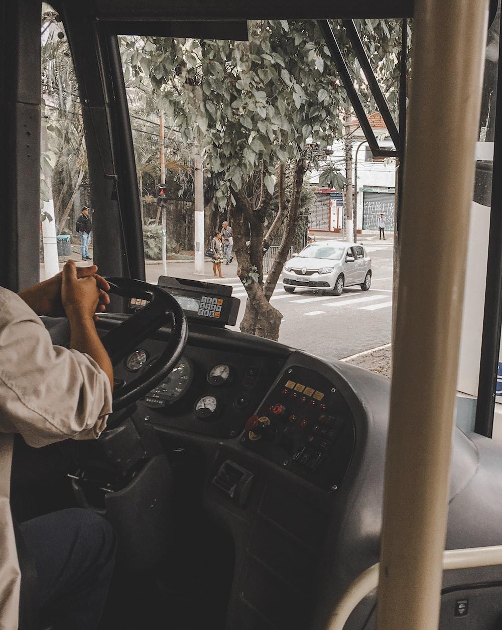 man sitting on driver seat