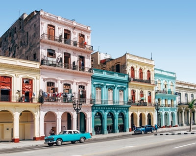two cars parked outside building cuba zoom background