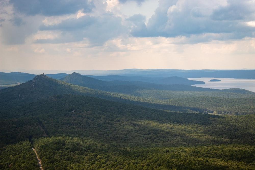 green hills near lake