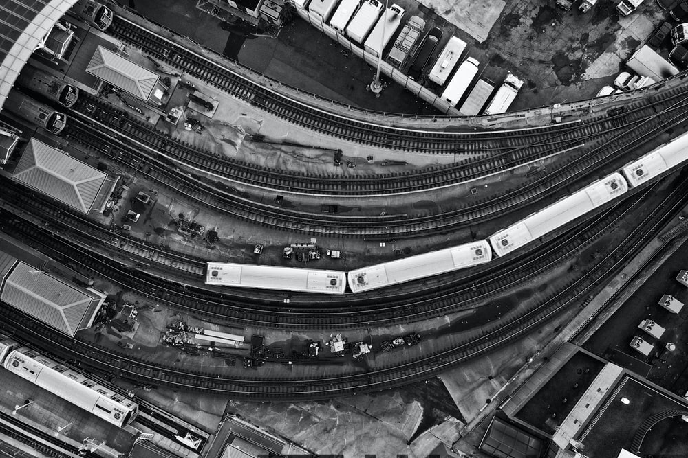 aerial view of greyscale photo of highway