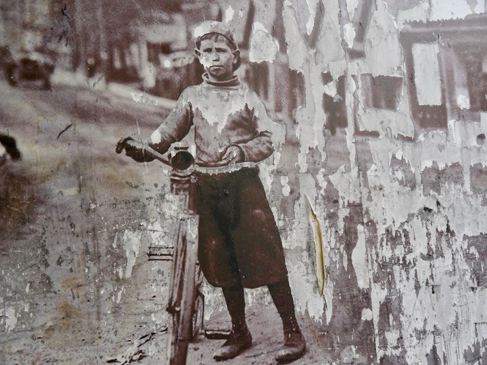 man standing beside wall