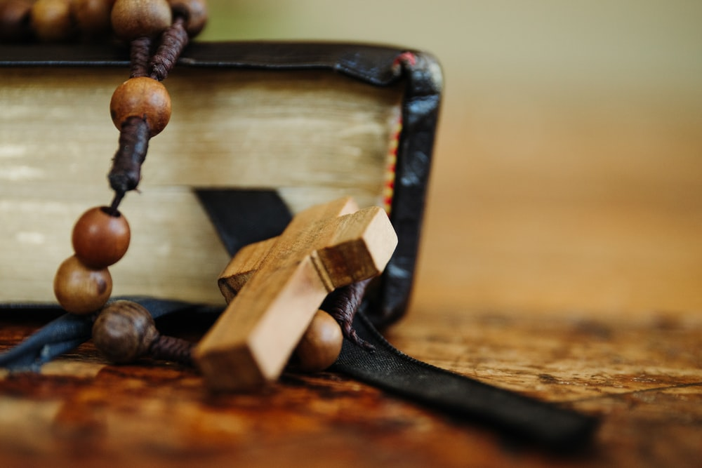 brown wooden cross on top of table