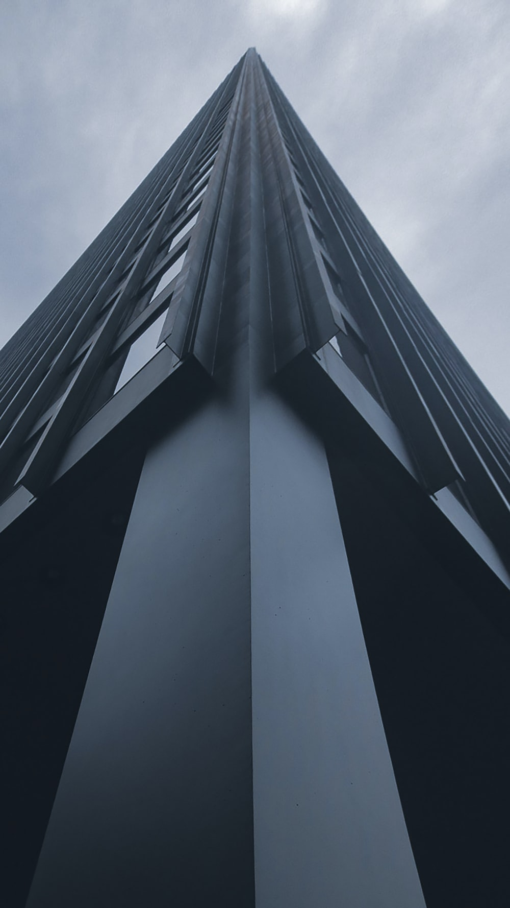 low-angle photo of high-rise building's edge