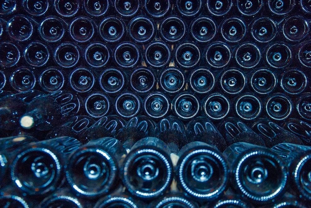 rows of black bottles