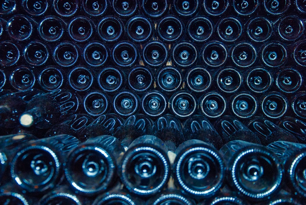 rows of black bottles
