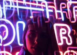 blue and pink neon light signage