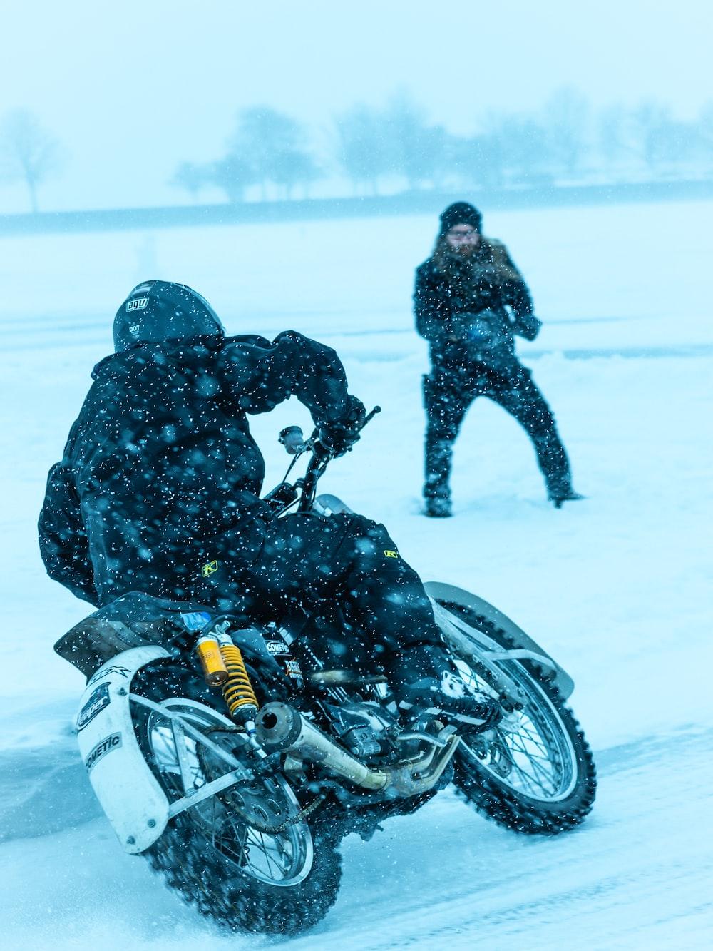 man riding motorcycle at snow