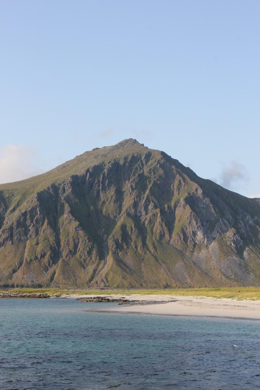 green mountain near ocean