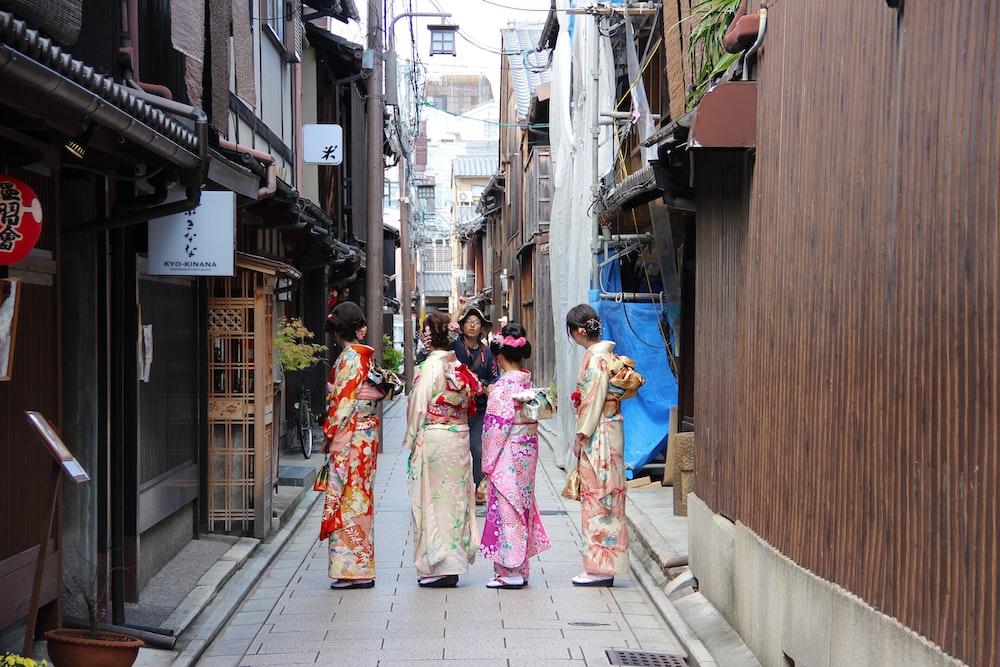 four women wearing geisha costumes at daytime