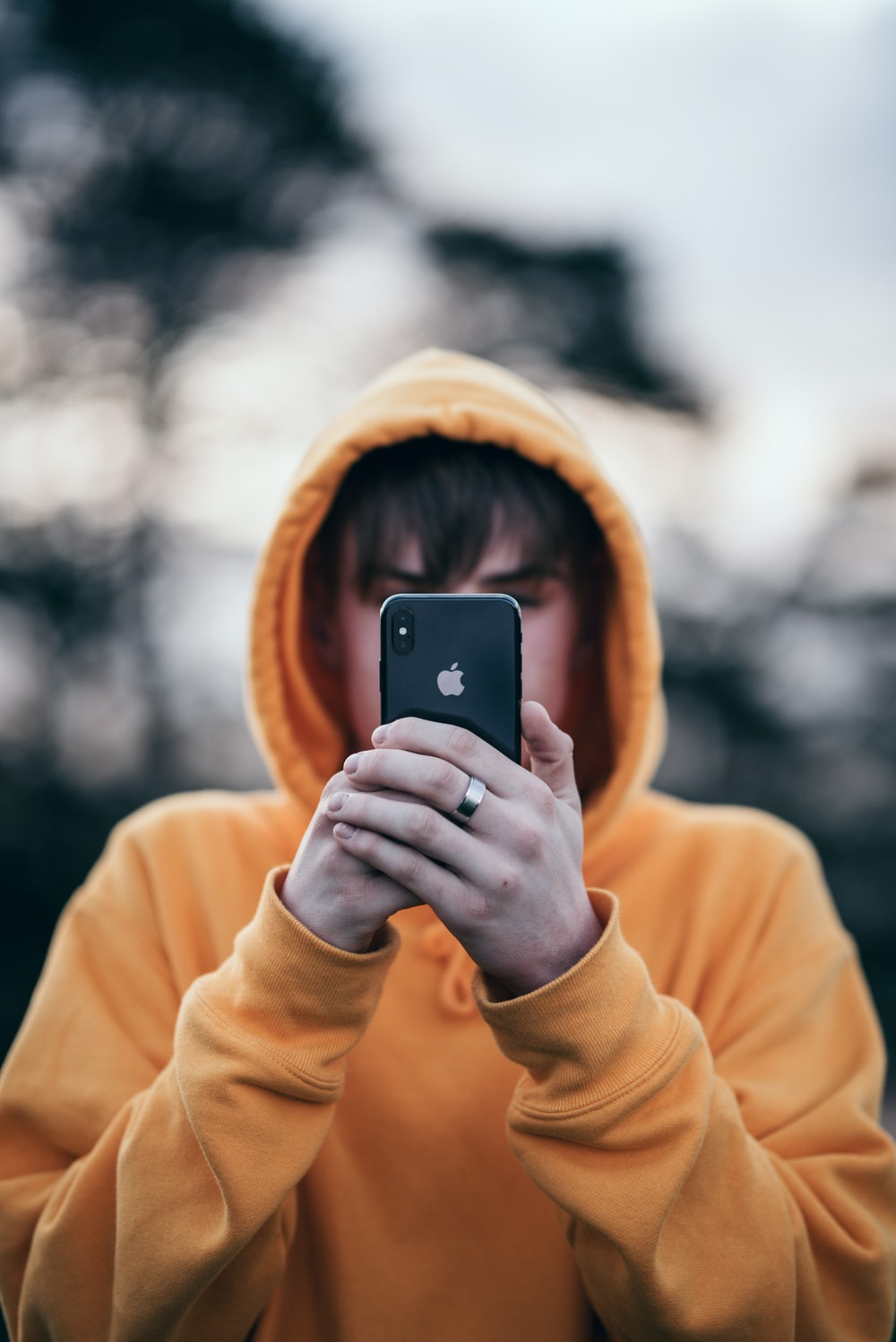 Man Holding Iphone X Photo Free Clothing Image On Unsplash