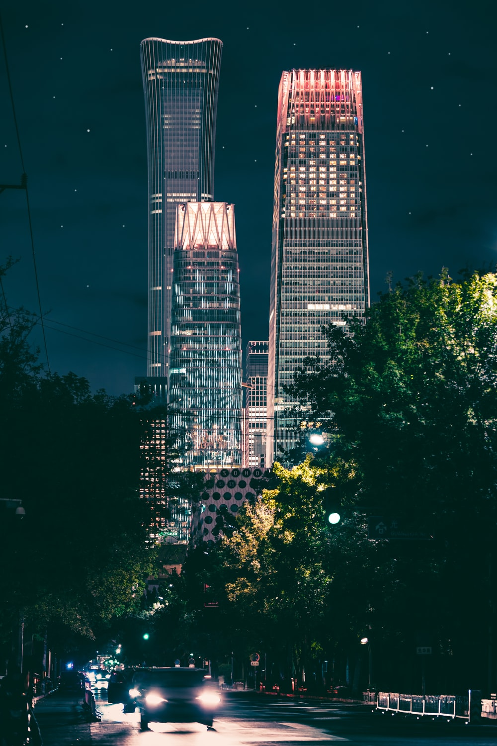 high-rise buildings with turned-on lights at nighttime