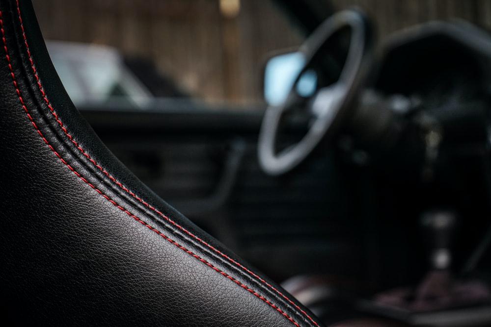 selective focus photography of black vehicle interior