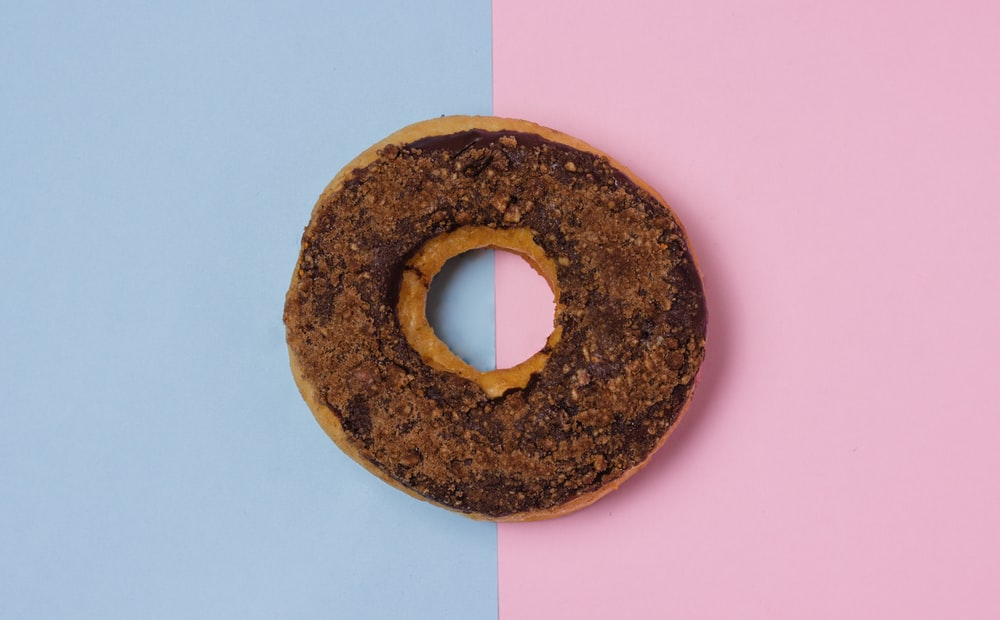 doughnut on pink and gray surface