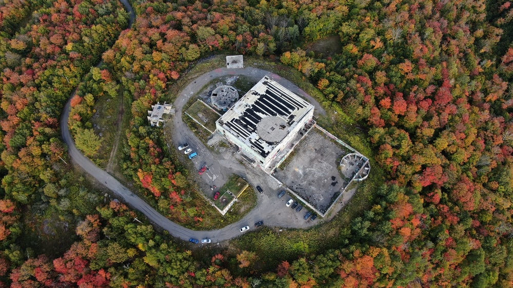 aerial photography of white concrete building surrounded by trees