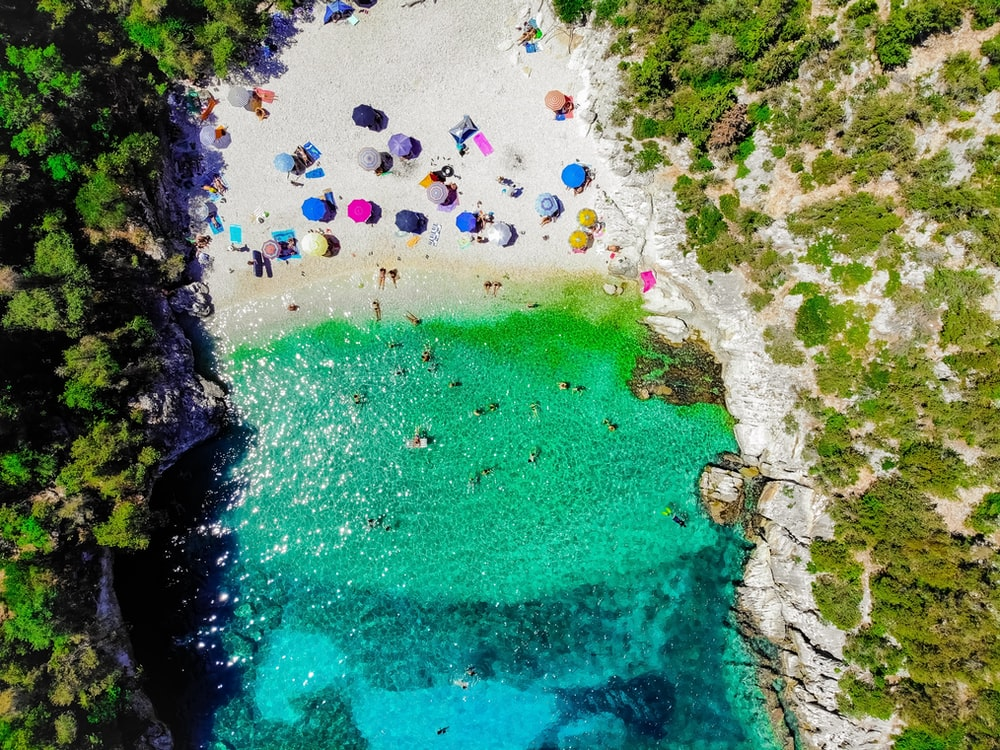 aerial photography of umbrellas on seashore during daytime