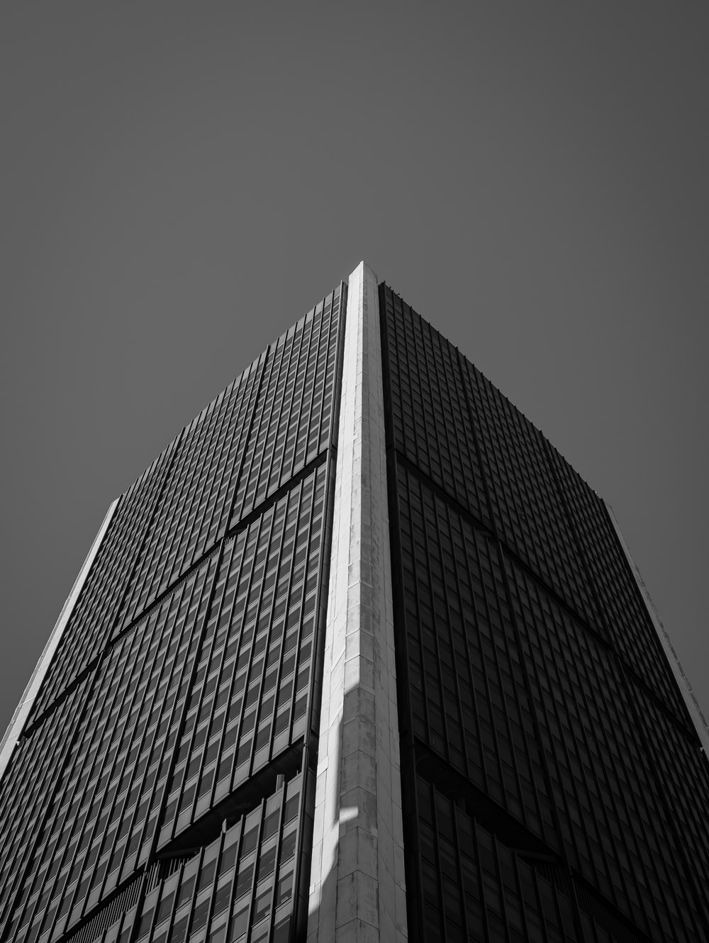 grayscale photography high-rise building