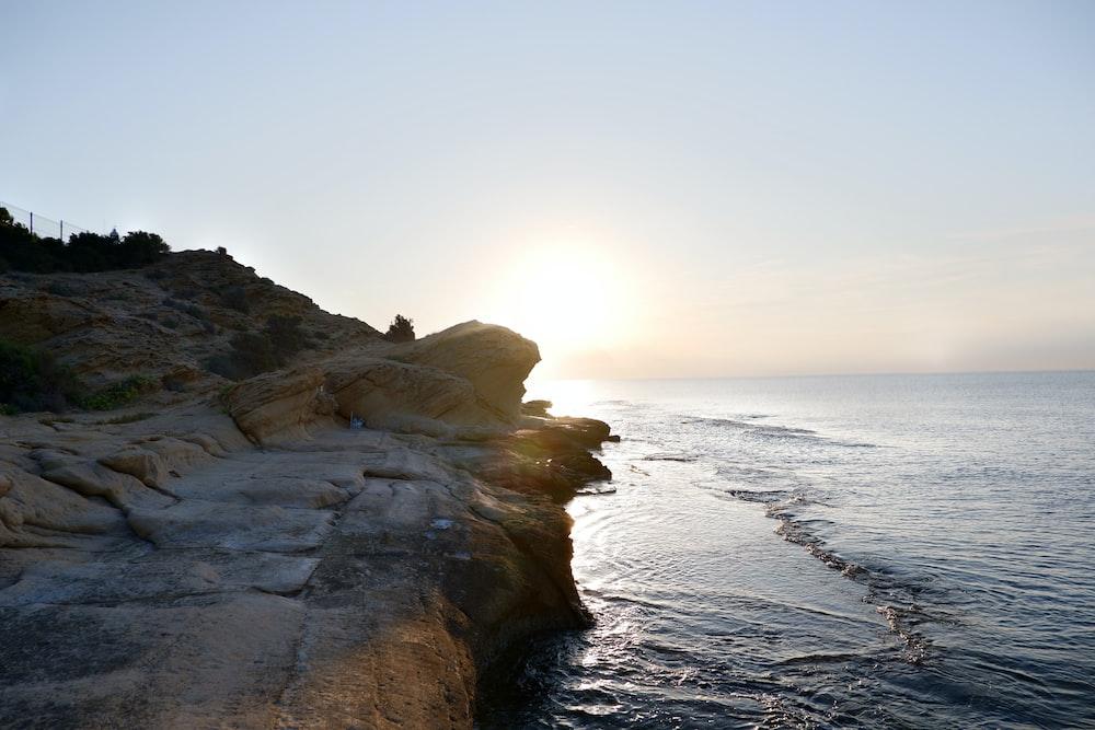 rock mountain near ocean