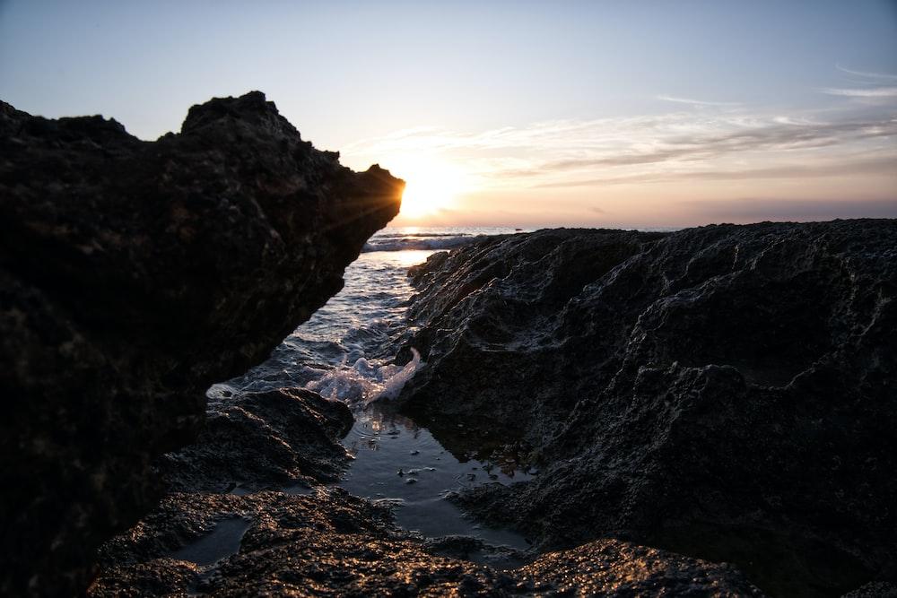 black rock formation at daytime