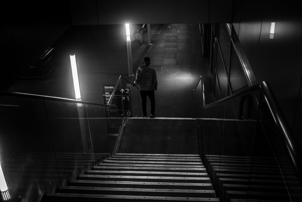 man standing on stairway