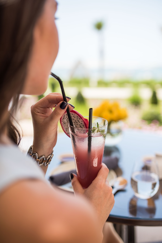 woman drinking dragon fruit juice