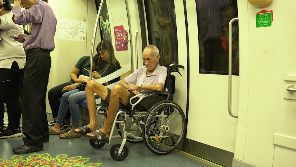 man sitting on black wheelchair