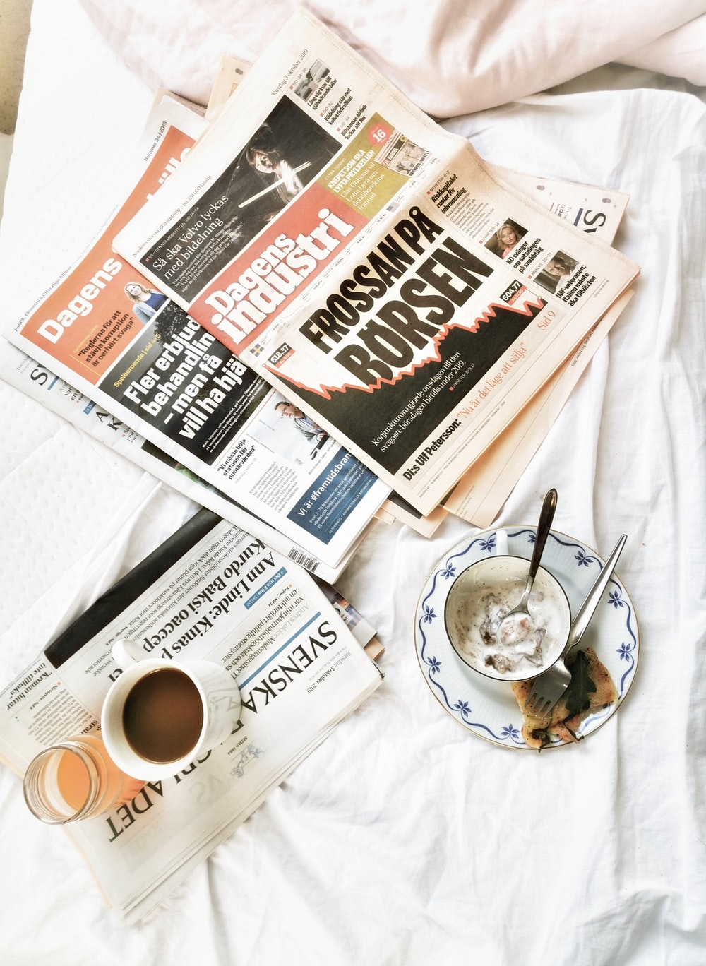 newspapers on white textile
