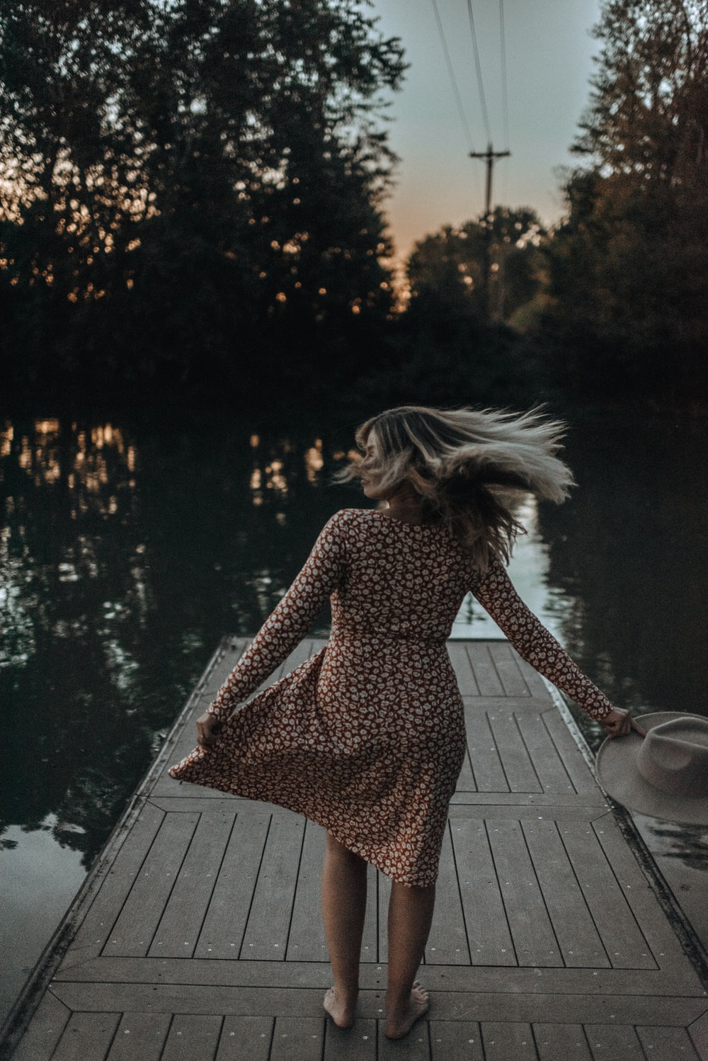 woman standing at a wooden dock