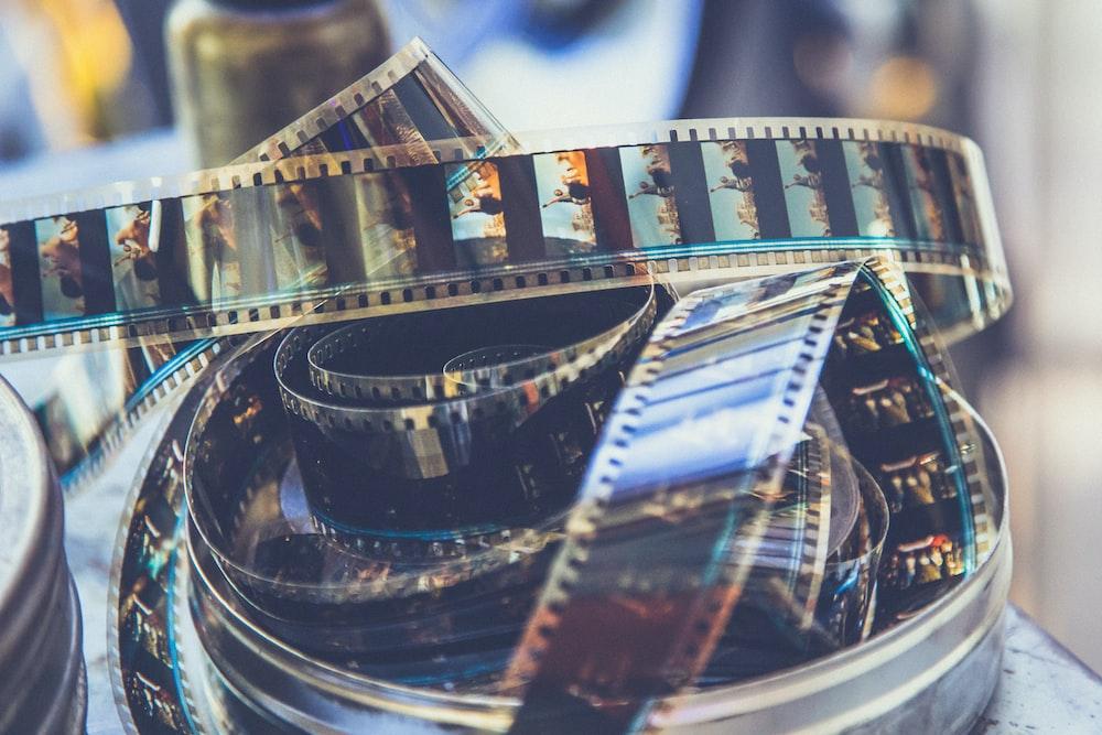 coil of black photo negative film
