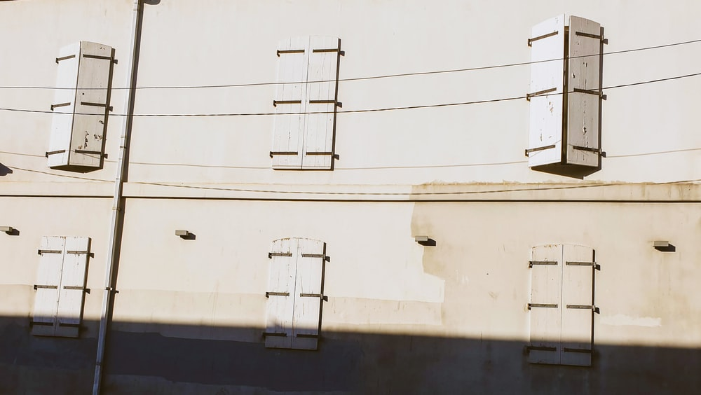 closed white wooden windows during daytime