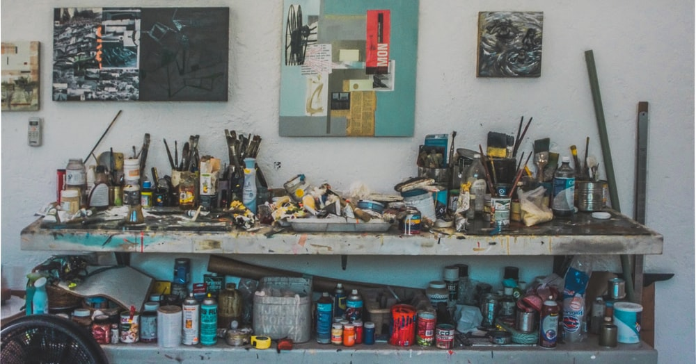 landscape photography of painting mediums on workbench