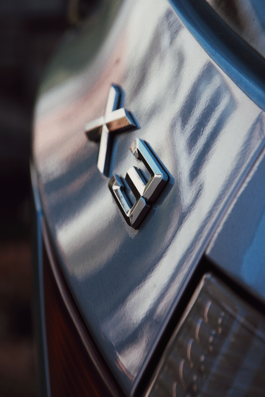 silver X3 car emblem