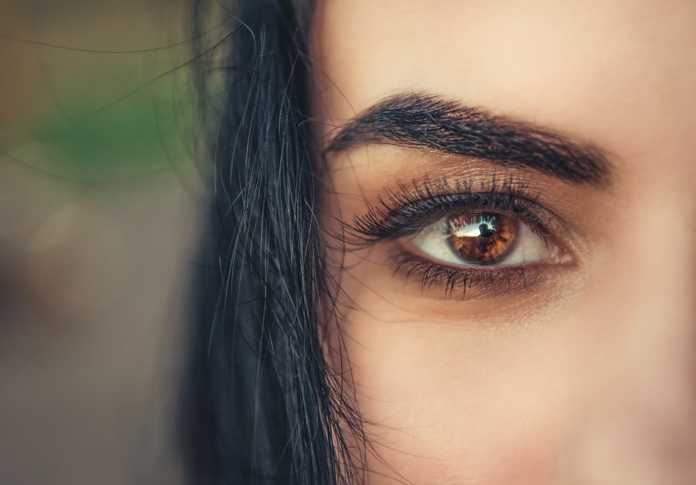 woman with right brown eye