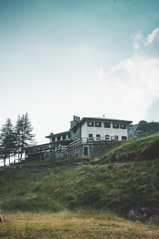 white concrete house under a calm blue sky
