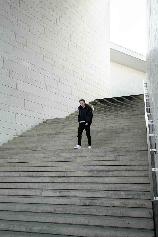 man walking near stairway during daytime