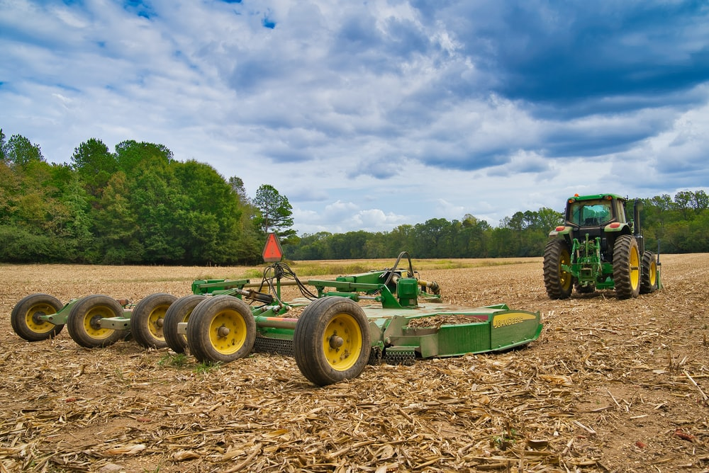 green tractor and green mower deck